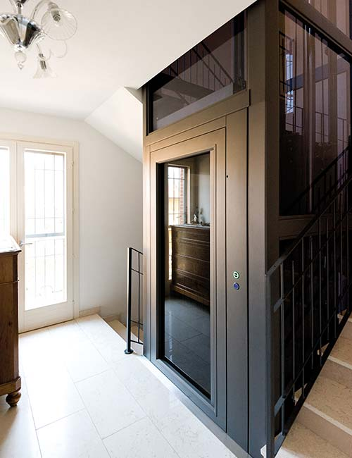 residential sovereign lift with matte black skin plates and tinted glass