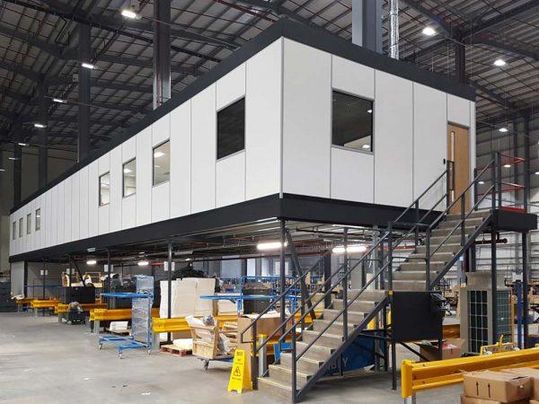 Mezzanine office built into industrial warehouse. Mezzanine inspiration for warehouse buildings.