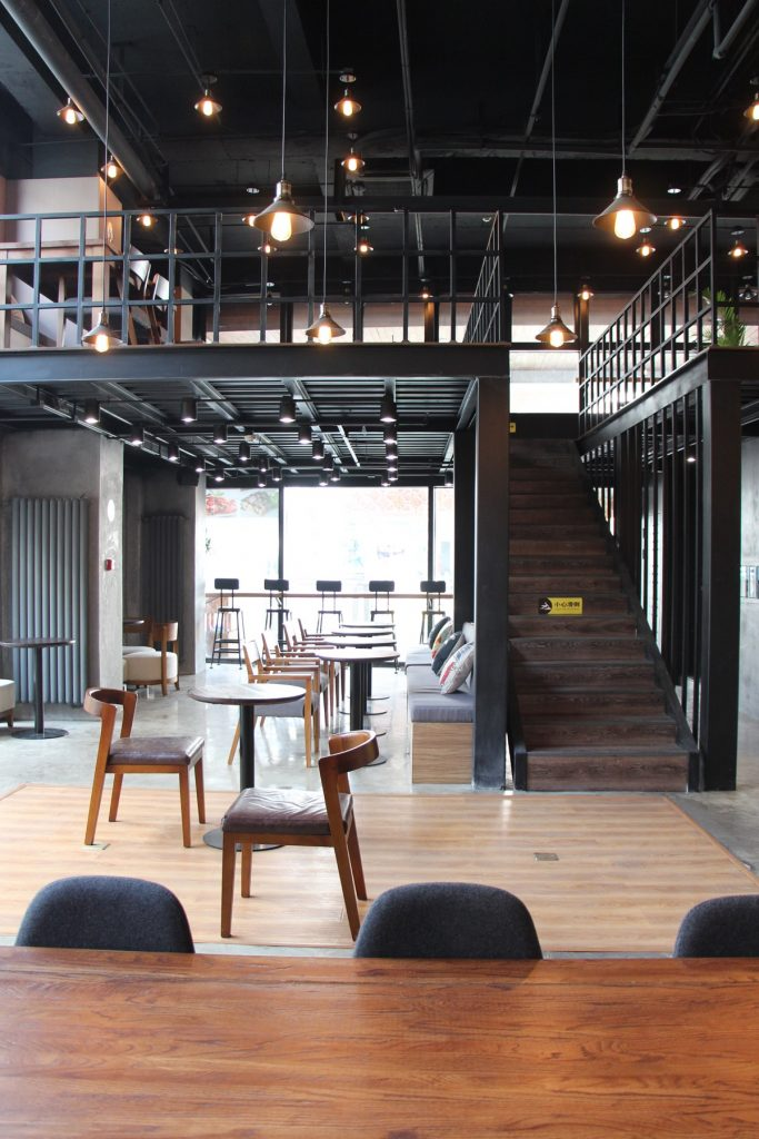 Mezzanine floor in BeanBar Cafe. Image shows how floor space is doubled without crowding customers. Inspiration picture to show how a mezzanine can be both practical and stylish.