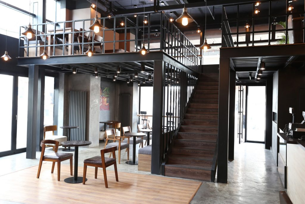BeanBar Cafe Mezzanine Inspiration. Mezzanine floor in BeanBar Cafe, China. Mezzanine is used to increase customer seating space without crowding cafe. Mezzanine is constructed out of black steel to match the cafe's industrial styling. Mezzanine transforms the space and ties in well with the cafes overall aesthetic.