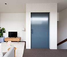 Stylish home lift installed in Brighton Melbourne by platinum elevators. Features bright blue statement door to fit with the homes existing interior design.