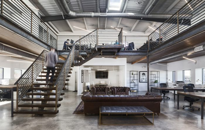 Image shows how mezzanines can be built into converted warehouses to maximise floor space and compliment the buildings design. Mezzanine inspiration for warehouse renovations.