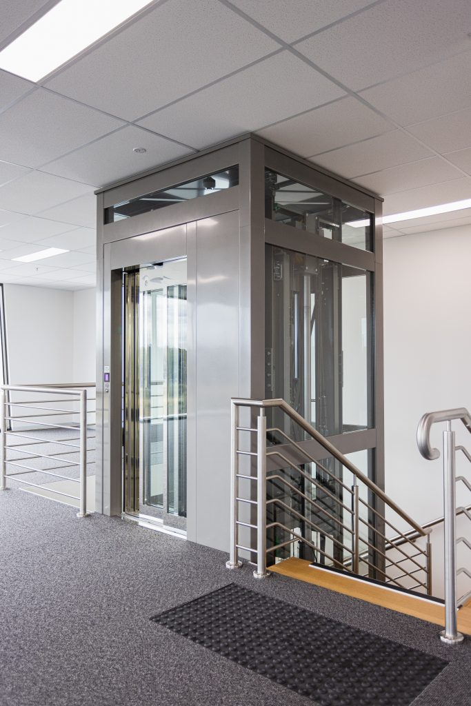 crown commercial lift next to stairs and railing in melbourne office setting