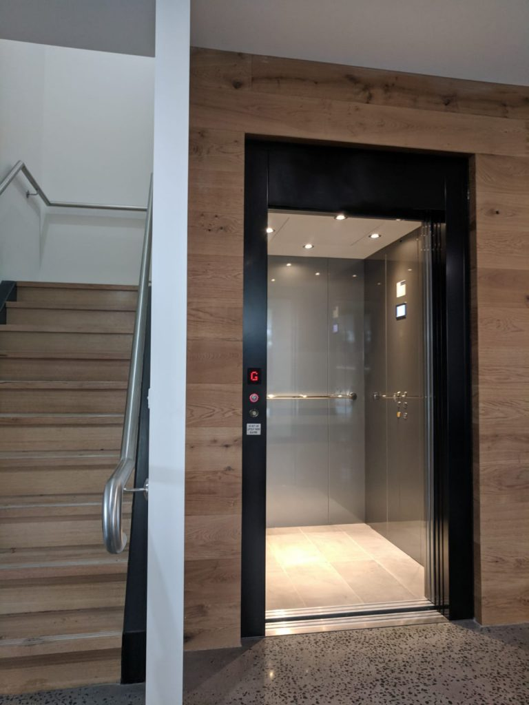 commercial lift with wooden wall feature