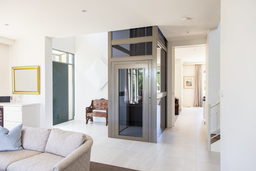 steel lift with grey colour with white interior surrounds