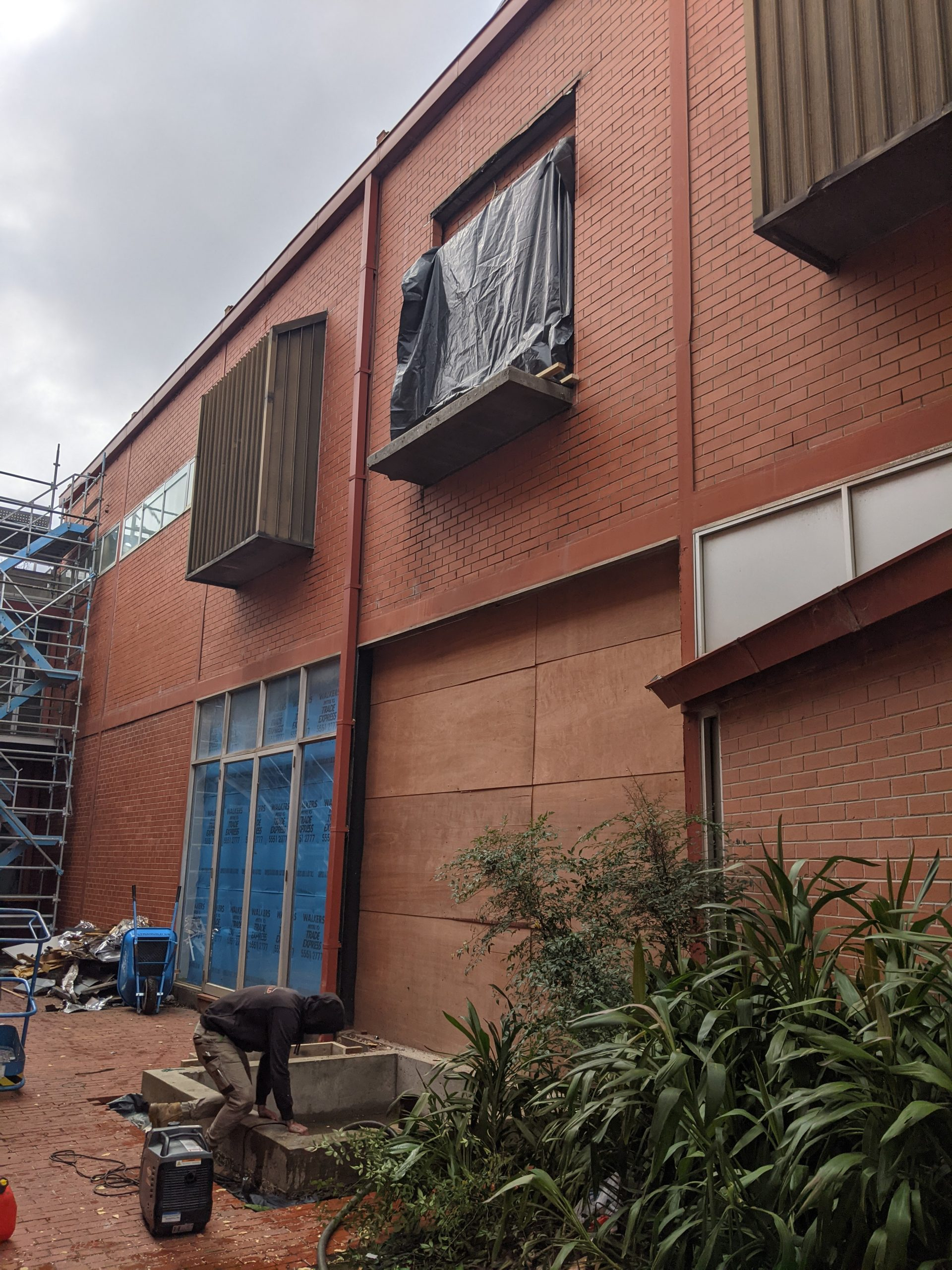 an external wall of a building with a space for an elevator entrance on the second floor