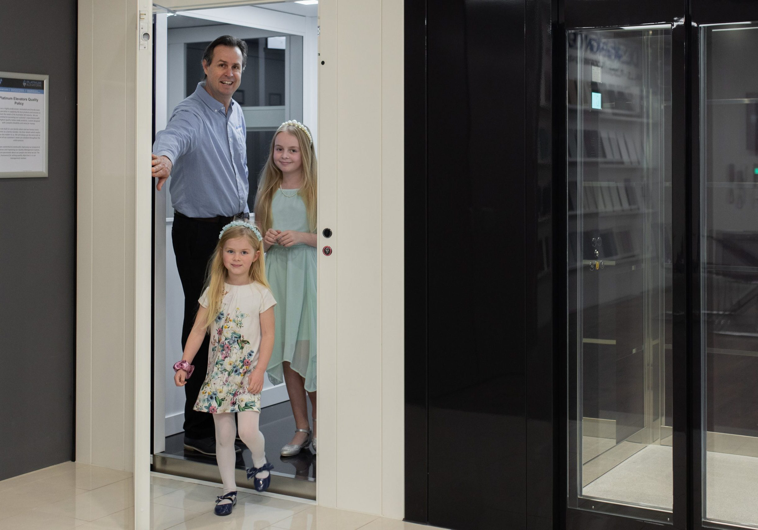 Man and two children existing a lift in the Melbourne lift showroom