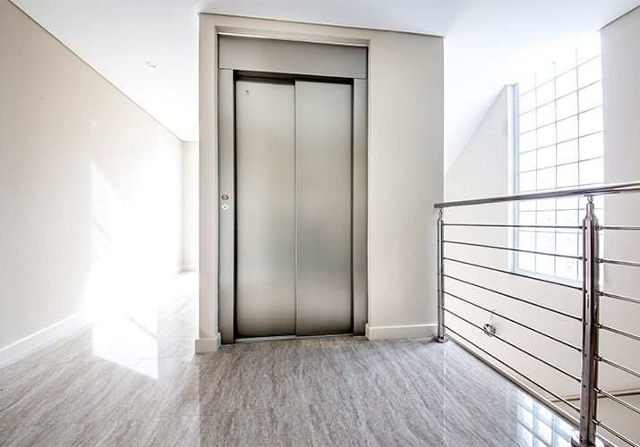 Minimalistic stainless steel home lift - residential royal design