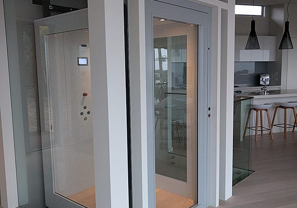 A residential lift installation in Fairhaven featuring white accents and wooden flooring.