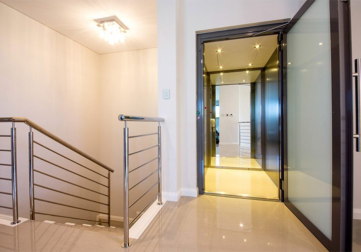 home lift with frosted glass and brushed stainless steel skinplates