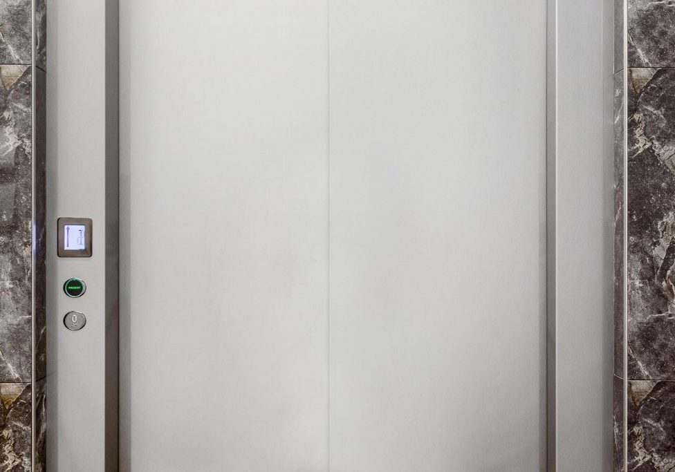 crown commercial lift built into marble wall