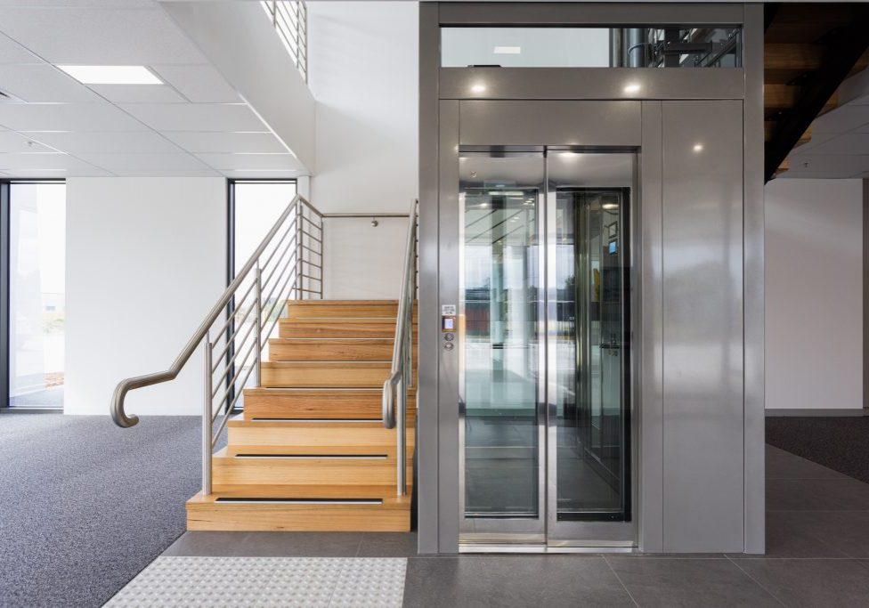 commercial lift built in void space of wooden stairwell