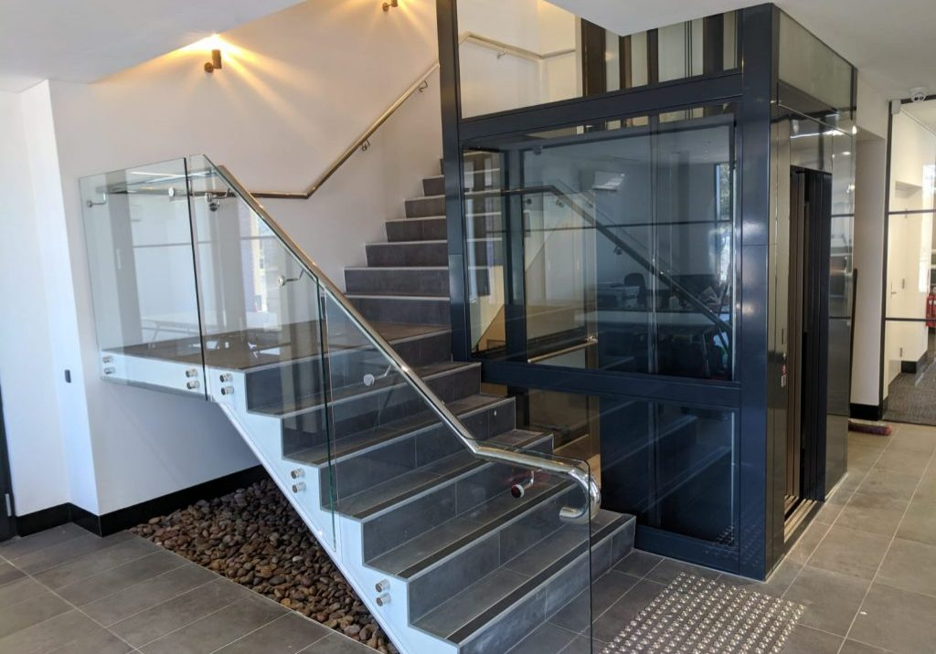 black lift with a large cabin next to stairs
