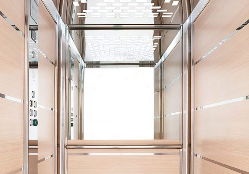 maxi lift with light wooden panels and mirrored details
