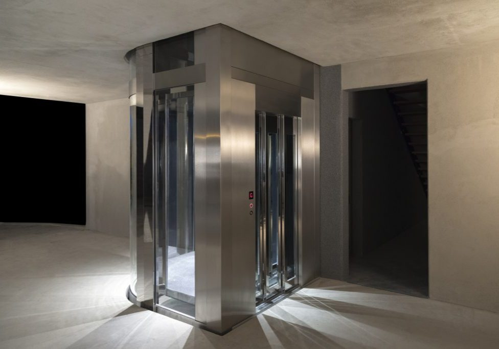 Stainless steel and glass home lift.