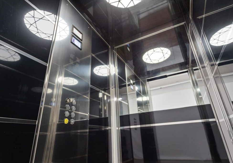 royal home lift with designer lighting, mirrored skinplates and digital displays