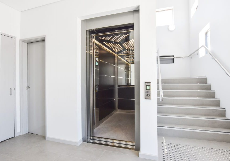 large commercial lift installed in the void space of a stairwell