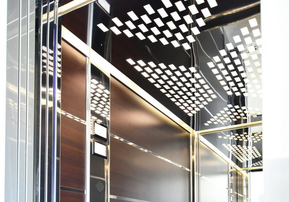 stretcher lift customised with designer lighting and wooden panels
